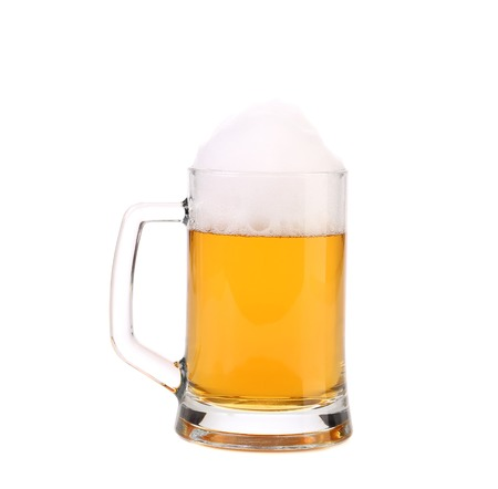 Mug of fresh beer with foam. Isolated on a white background. photo