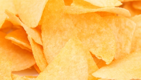 unhealthful: Background of potato chips. Close up.