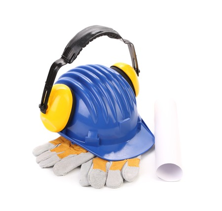 Ear muffs on hard hat and gloves. Isolated on a white background. photo