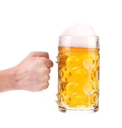 Hand holds mug of beer with foam. Isolated on a white background. Stock Photo - 22734544