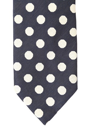 Polka dot necktie. Vertical.  Isolated on a white background photo