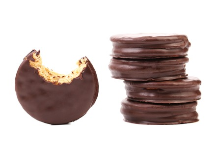 Bitten biscuit sandwich with chocolate. White background. photo