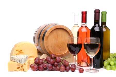Wine composition: barrel bottle and glasses of wine cheese grape photo