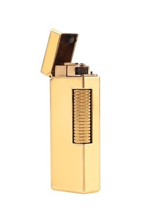 Elegant golden gas lighter. Isolated on a white background.