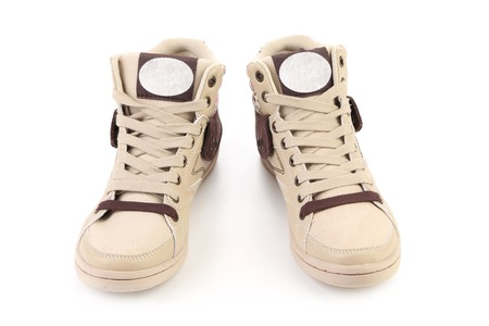 Fashion sneakers closeup. Isolated on a white background. photo