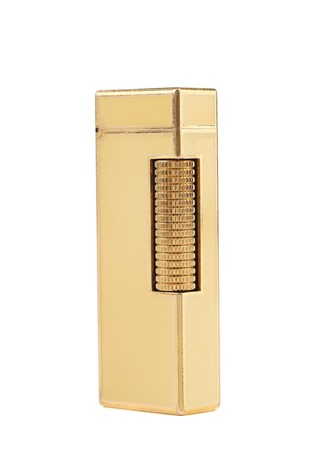 Elegant golden gas lighter. Isolated on a white background. photo