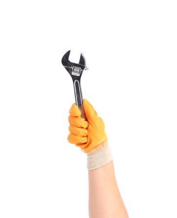 Hand in gloves holding wrench. Isolated on a white background. Stock Photo - 22735176