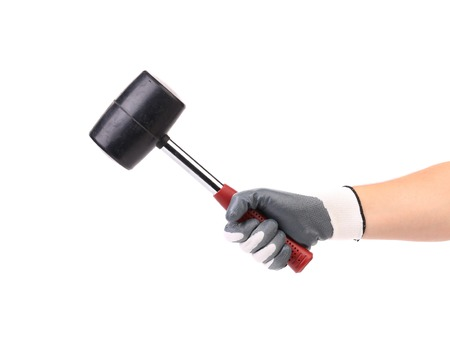 Hand in glove holding black hammer. Isolated on a white background. photo