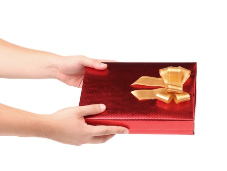 Hand holds gift box  isolated on a white background photo