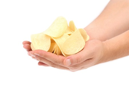 Potato chips on hands. Isolated on a white background. photo