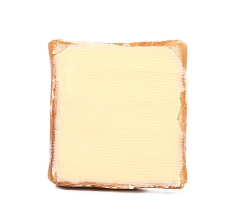 spreaded: Slice of wheaten bread spreaded with butter Stock Photo