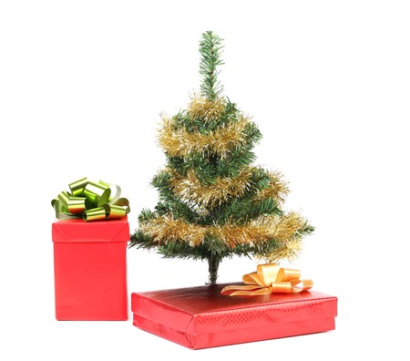 Christmas tree with two present boxes. Isolated on a white background. photo