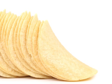 titbits: Potato chips. Isolated on a white background. Stock Photo