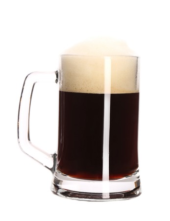 Big mug full with beer. Isolated on a white background. photo
