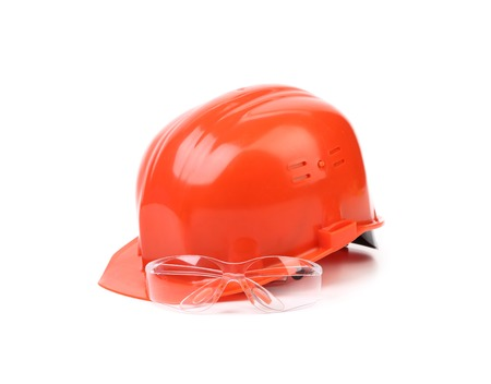 Red hard hat and glasses. Isolated on a white background. photo