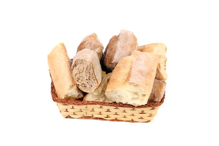 Torned bread in basket. Isolated on a white background. photo