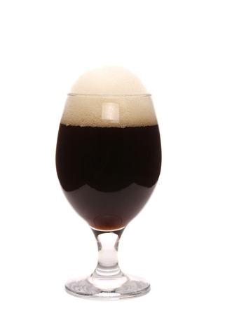 Closeup of brown beer glass. Isolated on a white background. photo