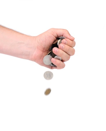 Men hand pour down coins.  Isolated on a white background photo