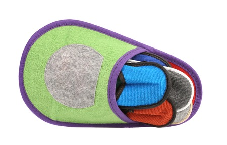 Colourful slippers into big slipper. Isolated on a white background Stock Photo - 22782795