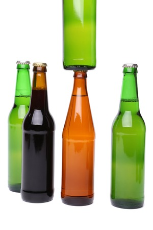 closing time: Five bottles of beer on the white background