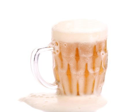 un bottled: Frosty glass of light beer. Isolated on a white background