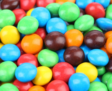 Background of chocolate balls in colorful glaze. Whole background. photo