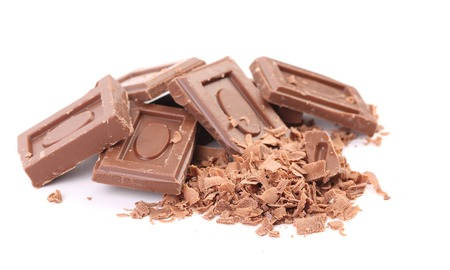morsel: Tasty morsel of milk chocolate. Isolated on a white background.