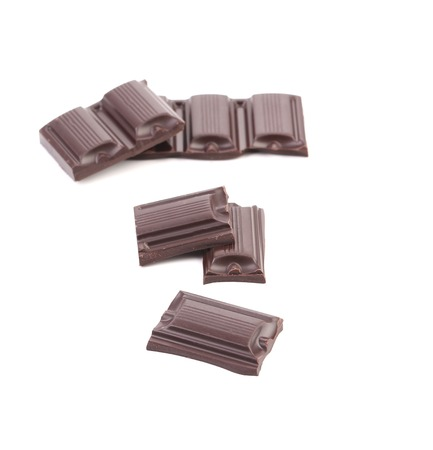Tasty morsel of dark chocolate. Collage. Isolated on a white background. photo