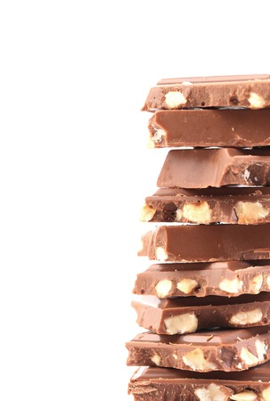 morsel: Tasty morsel of milk chocolate with nuts. Isolated on a white background.