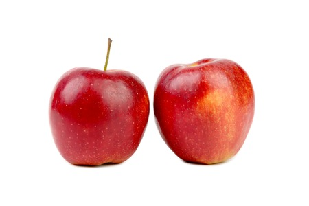 Two fresh red apples. Isolated on a white background. photo