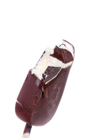 magnum: Bitten chocolate vanilla ice cream on stick. Isolated on a white background.