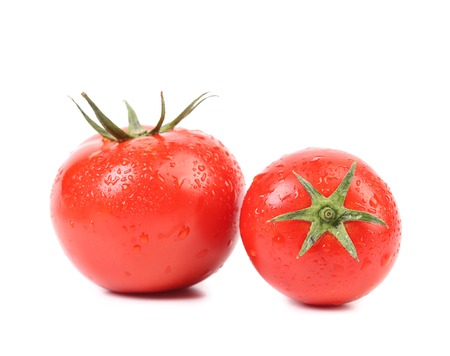 Tomatoes with drops. Isolated on a white background.