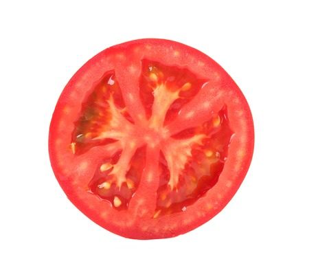 Fresh slice of tomato on white background photo