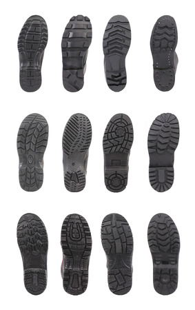 Different black shoe soles. Isolated on a white background. photo