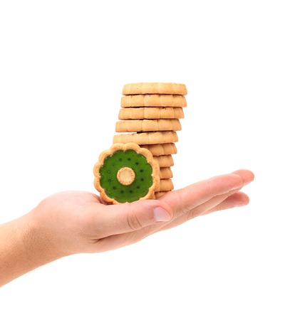 hand jam: Biscuits with kiwi jam on hand. Isolated on a white background.