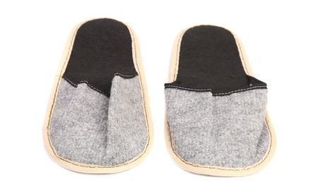 houseshoe: Pair of gray slippers. Isolated on a white background.