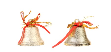 Two silver jingle bells. Isolated on a white background. photo
