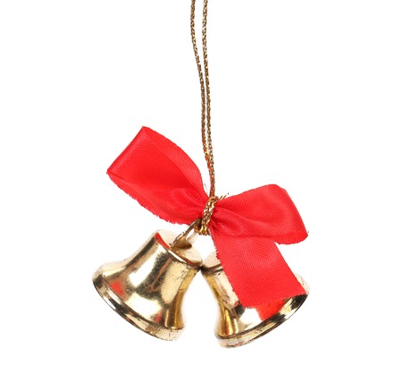 Two christmas bells with red ribbon. Isolated on a white background. photo