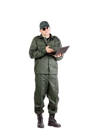 Man in workwear stands with notebook. Isolated on a white background. photo