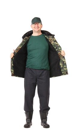 Worker in opened military vest. Isolated on a white backgropund. photo