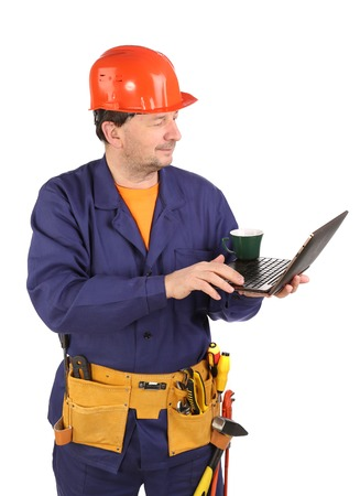 Worker with cup of coffee and laptop. Isolated on a white backgropund. photo