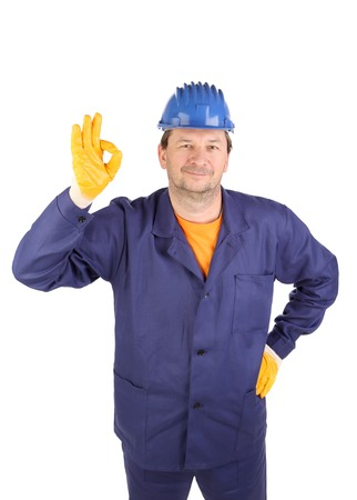 okey: Worker shows hand sign okey. Isolated on a white backgropund.
