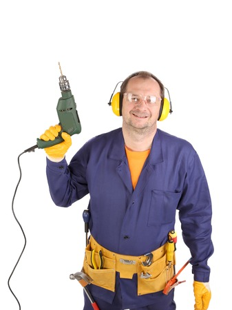 Worker in ear muffs and glasses with drill. Isolated on a white backgropund. photo