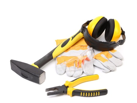 Protective ear muffs gloves and tools. Isolated on a white background photo