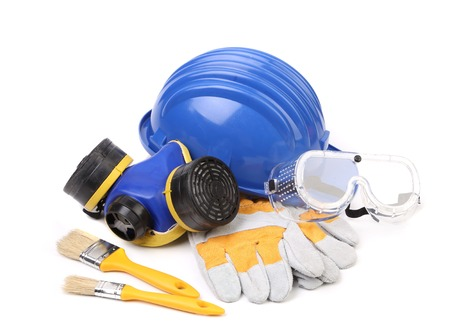 Blue hard head gloves and tools. Isolated on a white background Stock Photo