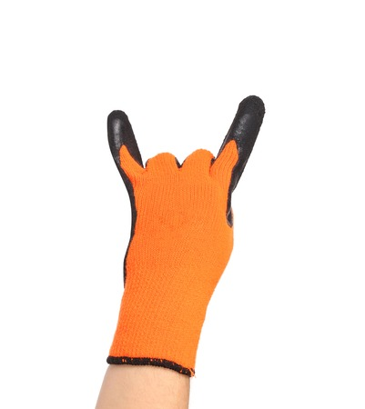 sternly: Hand in orange rubber protective glove shows rock sign. Isolated on a white background Stock Photo