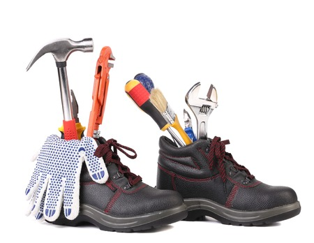 alligator wrench: Working tools in boots. Isolated on a white backgropund. Stock Photo