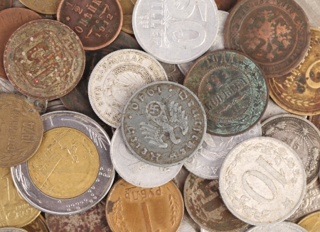 Close up of old coins. Isolated on a white backgropund. photo