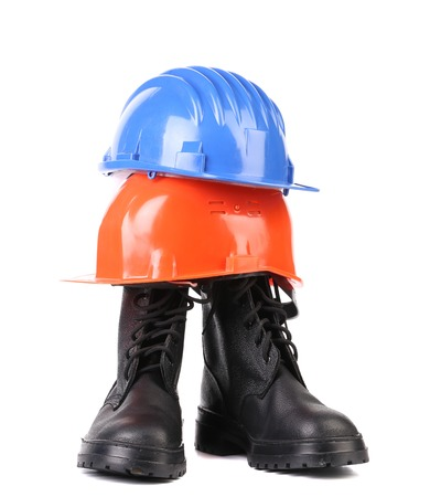 Hard hat and working boots. Isolated on a white backgropund. photo