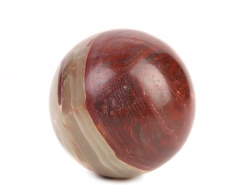 Close up small ball of jasper. Isolated on a white background. photo